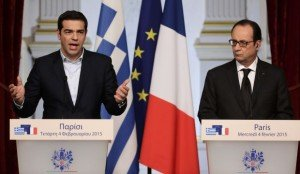 French President Hollande and Greek Prime Minister Tsipras attend a joint statment at the Elysee Palace in Paris